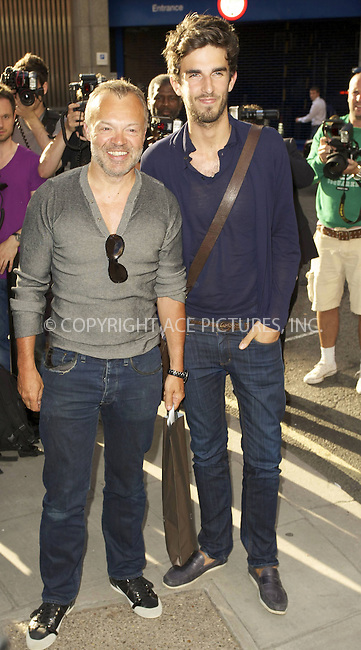 """WWW.ACEPIXS.COM . . . . .  ..... . . . . US SALES ONLY . . . . .....Graham Norton (L)  at the private view for """"Mario Testino: Kate Who?"""" on July 5 2010 in London....Please byline: FAMOUS-ACE PICTURES... . . . .  ....Ace Pictures, Inc:  ..tel: (212) 243 8787 or (646) 769 0430..e-mail: info@acepixs.com..web: http://www.acepixs.com"""