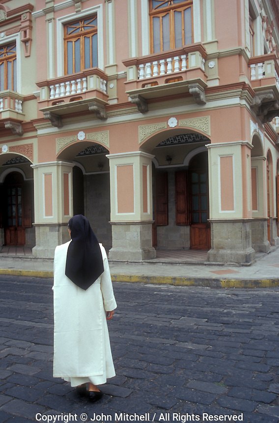 Catholic nun crossing a street in the city of Riobamba, Ecuador