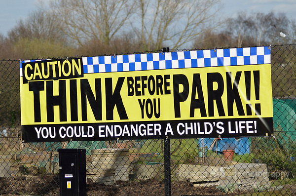 'Think before you Park' sign near a primary school.