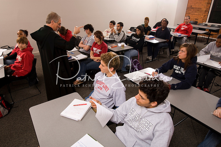 College students listen and take notes during a lecture from their professor in a classroom in Belmont, NC.