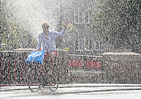 A man reacts with water in Amsterdam on 19 August, 2012. Whit temperatures of around 38 degrees centigrade this was the hottest day of the year in Netherlands. - PHOTO/PAULO AMORIM..