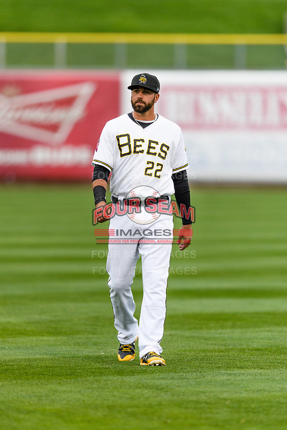 Kaleb Cowart (22) of the Salt Lake Bees warms up in the outfield before the game against the Sacramento River Cats in Pacific Coast League action at Smith's Ballpark on April 11, 2017 in Salt Lake City, Utah. The River Cats defeated the Bees 8-7. (Stephen Smith/Four Seam Images)