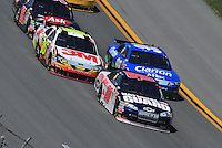 Apr 26, 2009; Talladega, AL, USA; NASCAR Sprint Cup Series driver Dale Earnhardt Jr (88) leads Greg Biffle (16) and Carl Edwards (99) during the Aarons 499 at Talladega Superspeedway. Mandatory Credit: Mark J. Rebilas-