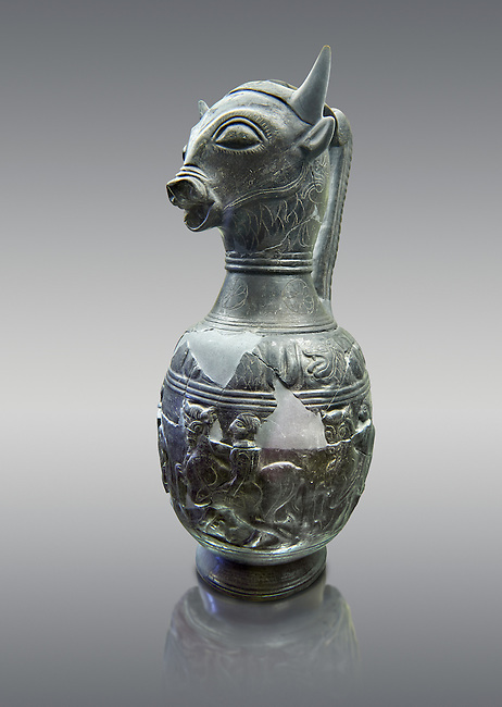Three quarters view of the 6th century BC Etruscan Bull headed bucherro style oinochoe, or wine jug,  made in Chuisi and excavated from the necropolis de Fonte Rotella, inv 3190, National Archaeological Museum Florence, Italy , against grey