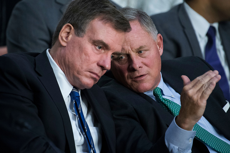 "UNITED STATES - AUGUST 01: Chairman Richard Burr, R-N.C., right, and Vice Chairman Mark Warner, D-Va., conduct a Senate (Select) Intelligence Committee hearing in Hart Building titled ""Foreign Influence on Social Media Platforms: Perspectives from Third-Party Social Media Experts,"" on August 1, 2018. (Photo By Tom Williams/CQ Roll Call)"