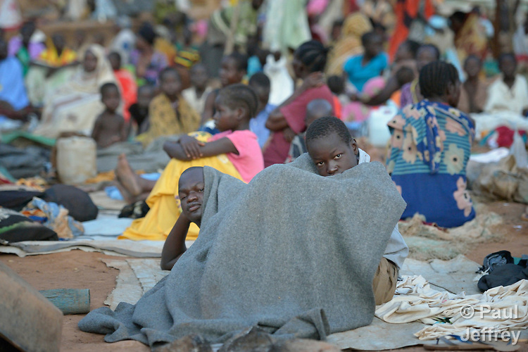 People waking up in the morning after sleeping in the open in a camp for over 5,000 internally displaced persons in an Episcopal Church compound in Wau, South Sudan. Most of the families here were displaced by violence early in 2017, after a larger number took refuge in other church sites when widespread armed conflict engulfed Wau in June 2016.<br /> <br /> Norwegian Church Aid, a member of the ACT Alliance, has provided relief supplies to the displaced in Wau, and has supported the South Sudan Council of Churches as it has struggled to mediate the conflict in Wau.