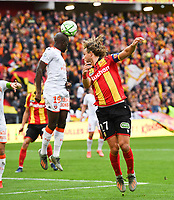 20191102 – Lens , France : Guillaume Gillet (27) of Lens pictured in a duel with Yoane Wissa (19) of Lorient during a French Ligue 2 soccer game between Racing Club de Lens and FC Lorient , a football game on the 13th matchday in the French second league, on saturday 2 nd of November 2019 at the Stade Bollaert Delelis in Lens , France . PHOTO SPORTPIX.BE   DAVID CATRY
