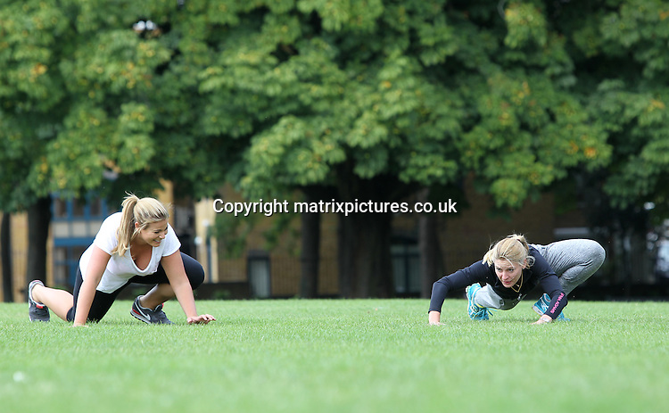 EXCLUSIVE PICTURE:  MATRIXPICTURES.CO.UK<br /> PLEASE CREDIT ALL USES<br /> <br /> WORLD RIGHTS<br /> <br /> Australian plus-size model Fiona Falkiner is pictured working out in a London park with her personal trainer.<br /> <br /> Eight years since sharing her weight-loss journey on the first season of The Biggest Loser Australia, Fiona is now making her mark internationally. Having moved to London from Sydney six months ago, Fiona is now brand ambassador for Yours Clothing UK and has just been signed by JAG Models in New York.<br /> <br /> Fiona is seen here with celebrity personal trainer Sophia Adams of NutrifitUK.com as they go through a bootcamp style workout in the park.<br /> <br /> AUGUST 18th 2014<br /> <br /> REF: MFF 143782