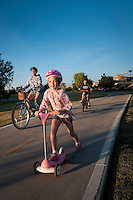 Ivett Melgarejo excercises with her son Joshua Berry, 10, and Natalia Berry, 6, in Chaparral Park in Scottdale on a Saturday afternoon. Riding bicycles or going skating, she on in-line skates and the children on scooters is her favorite way to get excercise.