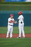 Orem Owlz manager Jack Santora (6) congratulates Jose Verrier (12) for hitting a double during a Pioneer League game against the Idaho Falls Chukars at The Home of the OWLZ on August 13, 2019 in Orem, Utah. Orem defeated Idaho Falls 3-1. (Zachary Lucy/Four Seam Images)