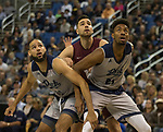 Nevada's forward Cody Martin, left, and  Jordan Brown go after a rebound against Little Rock's Dani Koljanin in the first half of an NCAA college basketball game in Reno, Nev., Friday, Nov. 16, 2018. (AP Photo/Tom R. Smedes)