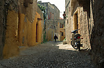 Motorcycle and Pedestrian on Side Street, Old Town, Rhodes, Greece