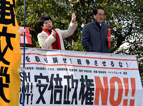 January 14, 2017, Tokyo, Japan - Opposition lawmaker Mizuho Fukushima, left, addresses an anti-government rally at Tokyo's Shibuya under the frigid mid-winter temperatures on Saturday, January 14, 2017. Hundreds of demonstrators took to the streets of the capital, calling for unification of the opposition power against the administration of Prime Minister Shinzo Abe. (Photo by Natsuki Sakai/AFLO) AYF -mis-