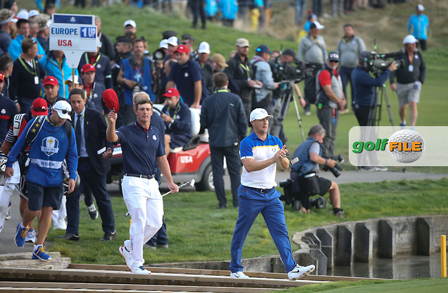 Alex Noren (Team Europe) walks to the 18th side by side with Bryson Dechambeau (Team USA) during Sunday's Singles, at the Ryder Cup, Le Golf National, Île-de-France, France. 30/09/2018.<br /> Picture David Lloyd / Golffile.ie<br /> <br /> All photo usage must carry mandatory copyright credit (© Golffile   David Lloyd)