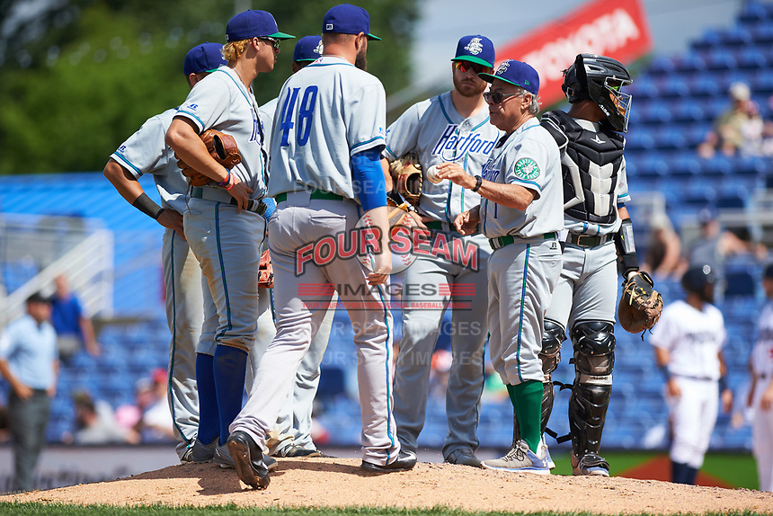 Hartford Yard Goats manager Jerry Weinstein (1) makes a pitching change to D.J. Johnson (48) as Josh Fuentes (13), Anthony Phillips (14), Luis Jean (17), Brian Mundell (15), and Jan Vazquez (6) look on during a game against the Binghamton Rumble Ponies on July 9, 2017 at NYSEG Stadium in Binghamton, New York.  Hartford defeated Binghamton 7-3.  (Mike Janes/Four Seam Images)