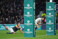 George Ford of England scores a try as Pat Lambie of South Africa attempts to catch him during the Old Mutual Wealth Series match between England and South Africa at Twickenham Stadium on Saturday 12th November 2016 (Photo by Rob Munro)