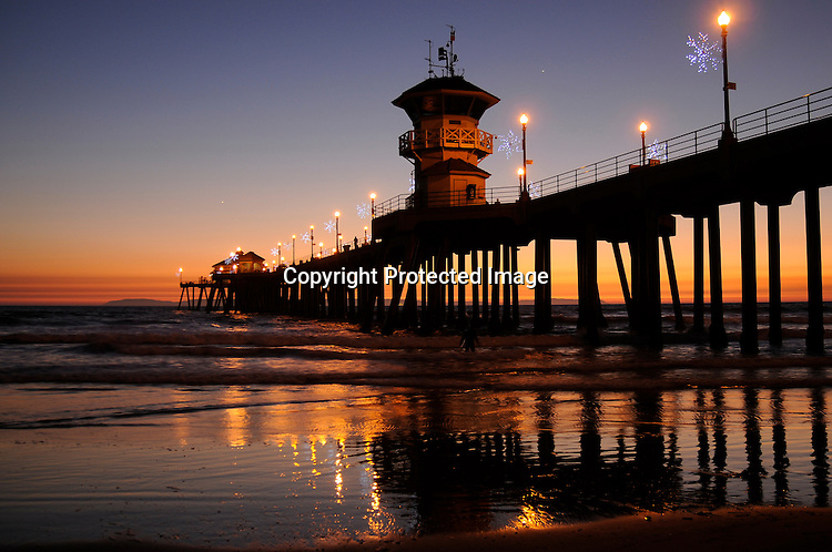 Stock Photo of Huntington Beach Pier at sunset located in Orange County California.