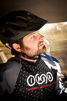 A mountain biker rides a shuttle while biking in Copper Harbor Michigan Michigan's Upper Peninsula.