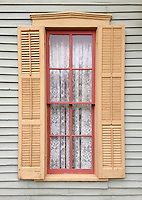 Shutters adorn a window oin a house in Bille Creek Village, a historic re-creation of nineteenth century life in Indiana, Rockville, Indiana