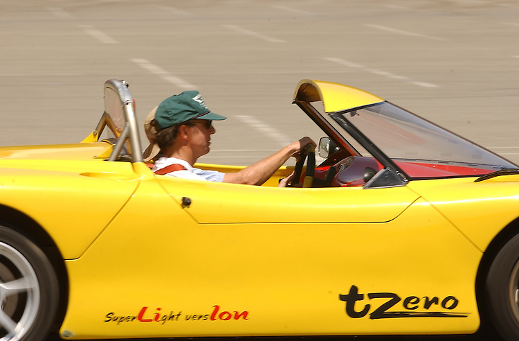 Experimental electric sports car T-Zero at the California Speedway in Fontana,  CA 3 September 2003.(Photo for The NYT/Gerard Burkhart)..-Writer Chris Dixon being shown how to drive through a slalom course by Tom Gage..-Dixon Driving the Slalom...