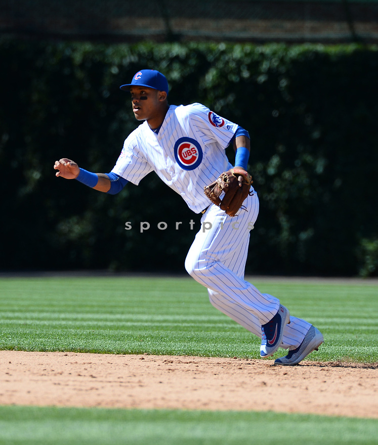 Chicago Cubs Addison Russell (27) during a game against the Pittsburgh Pirates on June 17, 2016 at Wrigley Field in Chicago, IL. The Cubs beat the Pirates 6-0.