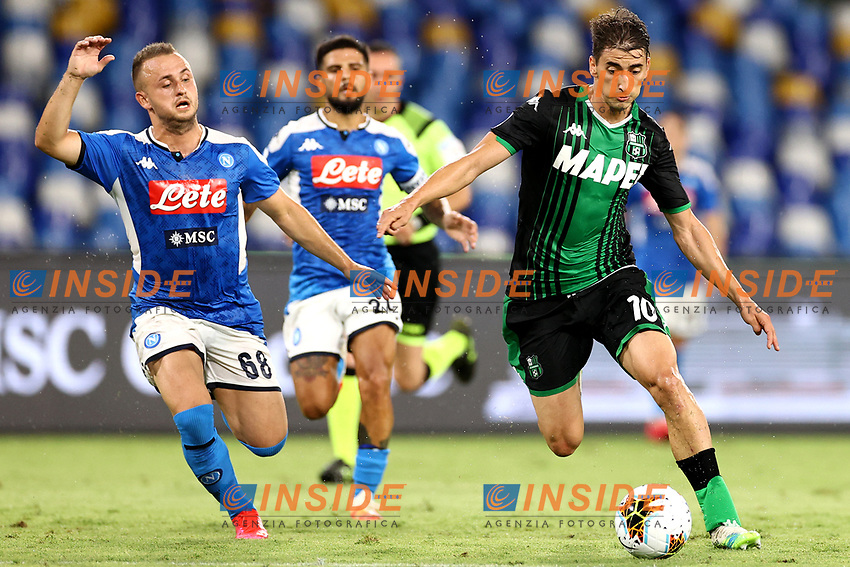 Stanislav Lobotka of SSC Napoli and Filip Djuricic of US Sassuolo compete for the ball during the Serie A football match between SSC Napoli and US Sassuolo at stadio San Paolo in Napoli ( Italy ), July 25th, 2020. Play resumes behind closed doors following the outbreak of the coronavirus disease. <br /> Photo Cesare Purini / Insidefoto