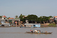 Mekong River<br /> , Cambodia - 2007 File Photo -<br /> <br /> <br /> fishing village huts, long boat.    <br /> <br /> <br /> <br /> photo : James Wong-  Images Distribution