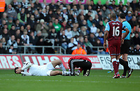 Pictured: Danny Graham of Swansea injured on the ground. Sunday 27 November 2011<br /> Re: Premier League football Swansea City FC v Aston Villa at the Liberty Stadium, south Wales.