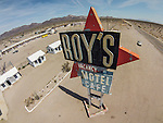 Marquee sign at the Historic Roy's motel and cafe from the air, along Route 66, Amboy, Calif., photographed from a sUAV/quadcopter.