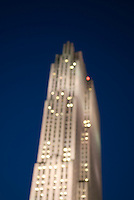 Defocused Upward View of 30 Rockefeller Plaza at Dusk, Rockefeller Center, Midtown Manhattan, New York City, New York State, USA