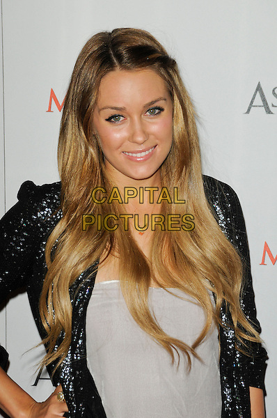 "LAUREN CONRAD .arriving at the Launch Party for ""Assassin's Creed II"" at Voyeur in West Hollywood, California, USA,.November 11th, 2009..half length hand on hip grey gray smiling silver sequined sequin jacket hair twist twisted .CAP/ROT.©Lee Roth/Capital Pictures"