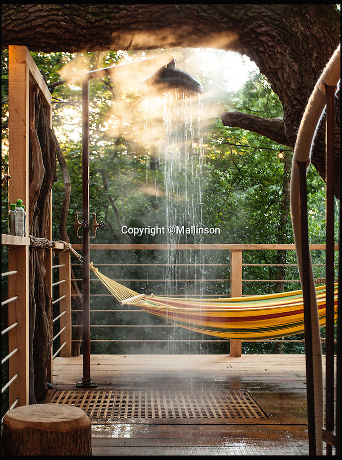 BNPS.co.uk (01202 558833)<br /> Pic: Mallinson/BNPS<br /> <br /> Outdoor shower and hammock...<br /> <br /> Release your inner Tarzan...in Britain's poshest treehouse.<br /> <br /> A luxury glamping site in deepest Dorset has created a luxurious treehouse that comes with its own sauna, hot tub, rotating fireplace and pizza oven.<br /> <br /> The Woodsman's Treehouse is perched 30ft from the ground on long stilts and has two floors. <br /> <br /> It has a spiral staircase and a stainless steel slide for quick access to the ground and can be rented out from £390 a night. <br /> <br /> It is located at the Crafty Camping glamping site at Holditch in west Dorset.