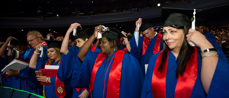 Students flip their tassels after receiving their degrees Saturday, June 10, 2017, during the DePaul University School for New Learning commencement ceremony at the Rosemont Theatre in Rosemont, IL. (DePaul University/Jeff Carrion)