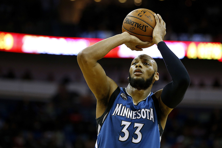Minnesota Timberwolves forward Adreian Payne (33) shoots the ball during the second half of an NBA basketball game Saturday, Feb. 27, 2016, in New Orleans. The Timberwolves won 112-110. (AP Photo/Jonathan Bachman)