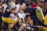 BYU Cougars running back Jamaal Williams (21) is tackled by Notre Dame Fighting Irish linebacker Carlo Calabrese (44) and defensive end Stephon Tuitt (7) in the second quarter.