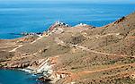 Coastal landscape Cabo de Gata natural park, looking west to the lighthouse, Almeria, Spain