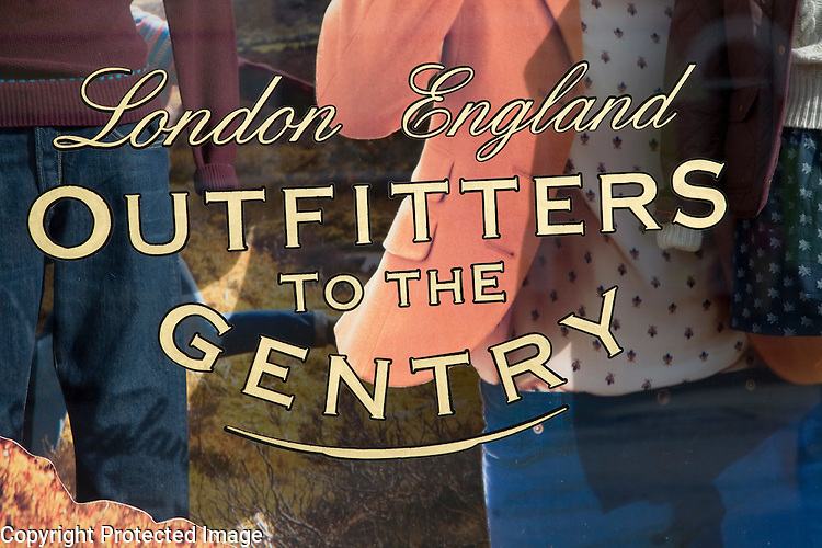 Outfitters to the Gentry shop window sign for an expensive men's clothing shop, Aldeburgh, Suffolk, England