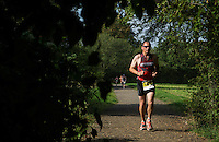 28 SEP 2014 - STOWMARKET, GBR - Alasdair Sutherland from Ipswich Triathlon Club makes his way round the 5km run course during the 2014 West Suffolk Triathlon in Stowmarket in Suffolk, Great Britain (PHOTO COPYRIGHT © 2014 NIGEL FARROW, ALL RIGHTS RESERVED)