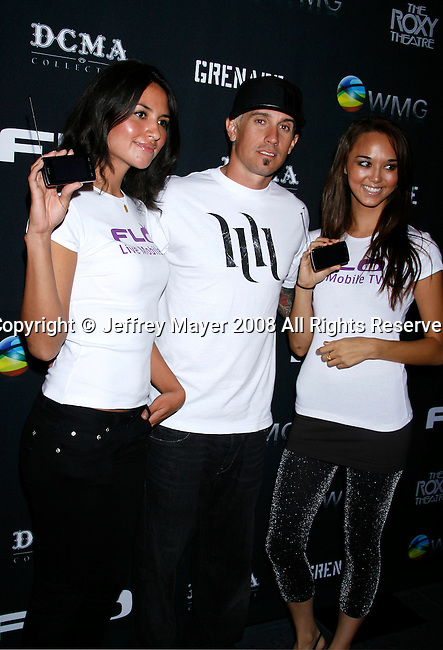 BMX Rider Carey Hart (C) and models arrive at Flo Live Mobile TV Presents X-Games After Party presented by  Flo Live Mobile TV at The Roxy on August 1, 2008 in West Hollywood, California.