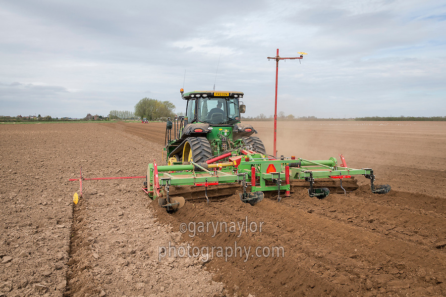 Cultivating for potatoes using a 6m Baselier rotary cultivator and john Deere tractor with Starfire autosteer - Lincolnshire, April