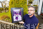 Titus Hara Castleisland with a picture of his daughter Diana who suffered a tragic brain injury after a hit and run in Romania