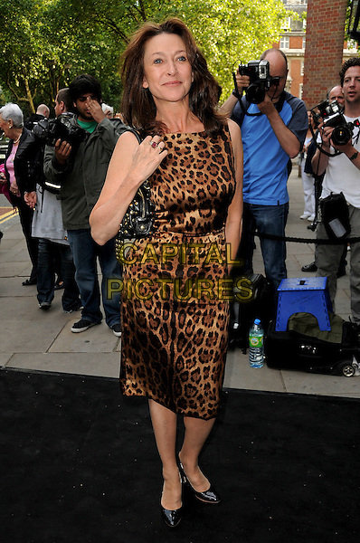"CHERIE LUNGHI.Opening Night of the ""Ballets Russes"" season at the Sadlers Wells Theatre, London, England. .June 16th, 2009 .full length brown black sleeveless leopard animal print silk satin dress .CAP/CAS.©Bob Cass/Capital Pictures."