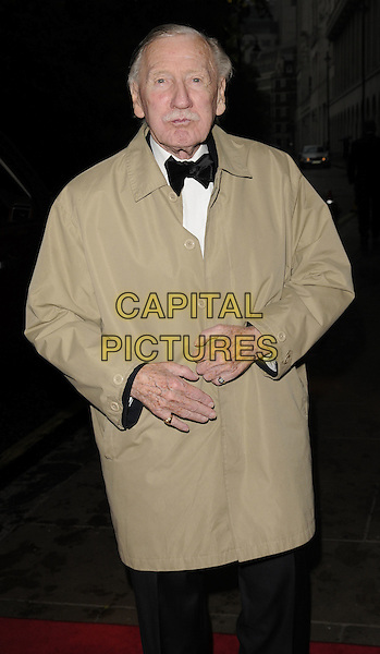 Leslie Phillips .Attending the Born Free Foundation Gala Dinner, The Savoy Hotel, London, England, UK, 17th June 2011..half length beige coat black bow tie  trousers tuxedo tux .CAP/CAN.©Can Nguyen/Capital Pictures.