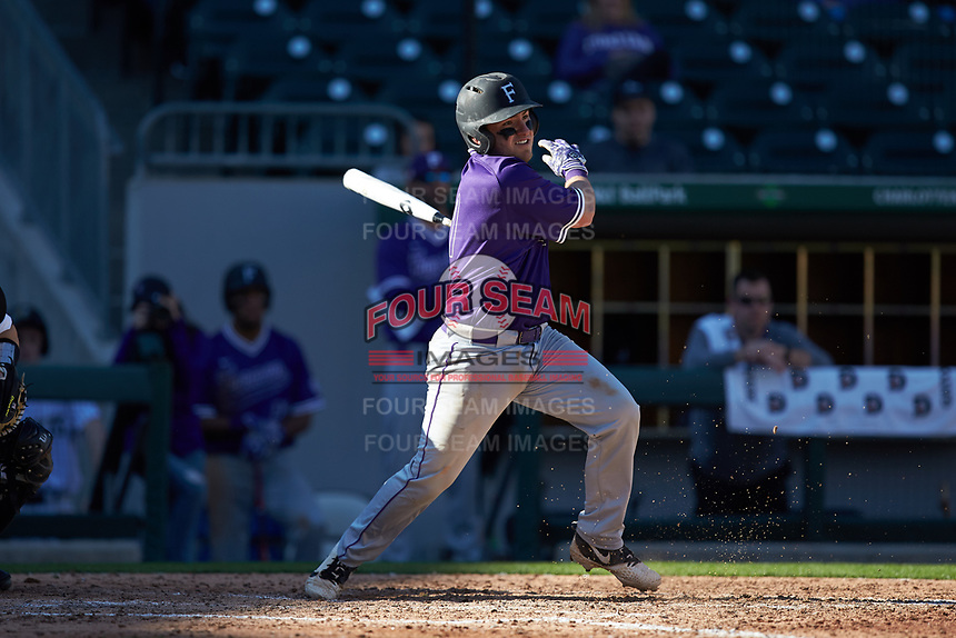 Logan Taplett (7) of the Furman Paladins follows through on his swing against the Wake Forest Demon Deacons at BB&T BallPark on March 2, 2019 in Charlotte, North Carolina. The Demon Deacons defeated the Paladins 13-7. (Brian Westerholt/Four Seam Images)