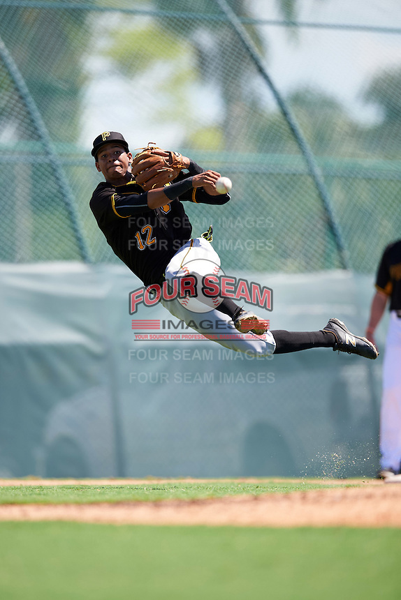 Pittsburgh Pirates third baseman Alfredo Reyes (12) throws to first base during an Instructional League Intrasquad Black & Gold game on September 21, 2016 at Pirate City in Bradenton, Florida.  (Mike Janes/Four Seam Images)