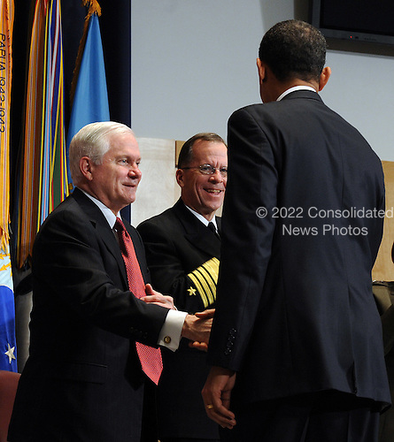 Washington, DC - March 12, 2009 -- United States President Barack Obama shakes hands with Secretary of Defense Robert Gates (L) and Chairman of the Joint Chiefs of Staff Adm. Michael Mullen (C) during the dedication of the Abraham Lincoln Hall at the National Defense University at Ft. McNair in Washington on Thursday, March 12, 2009.    .Credit: Roger L. Wollenberg - Pool via CNP