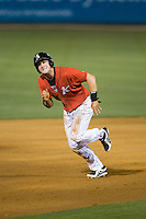 Hunter Jones (9) of the Kannapolis Intimidators takes off for third base during the game against the Lakewood BlueClaws at CMC-Northeast Stadium on May 16, 2015 in Kannapolis, North Carolina.  The BlueClaws defeated the Intimidators 9-7.  (Brian Westerholt/Four Seam Images)