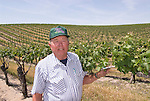 California, San Luis Obispo County: At Eberle Winery and vineyards in Paso Robles, noted for red wines.  Vineyard planter Howie Steinbeck. Model released..Photo caluis129-71044..Photo copyright Lee Foster, www.fostertravel.com, 510-549-2202, lee@fostertravel.com