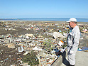 Takada-san Observes what remains of his devastated home at 1.53pm on March 12th, 2011 in Minami Souma, Fukushima Prefecture. A huge M8.9 earthquake hit Japan on Friday 11th March, 2011 followed by a giant tsunami causing death and destruction