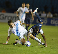 Guatemala's Elias Vasquez (3) and the USA's Maurice Edu (7) get tangled up fighting for a loose ball as the United States played Guatemala at Estadio Mateo Flores in Guatemala City, Guatemala in a World Cup Qualifier on Tue. June 12, 2012.